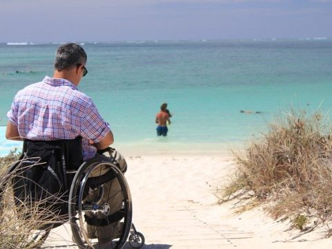Man in Wheelchair at the Beach